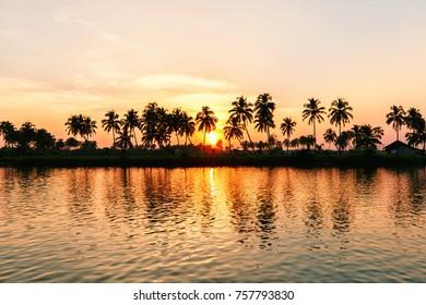 Beautiful sunset in tropics. River Sal, South GOA, India.