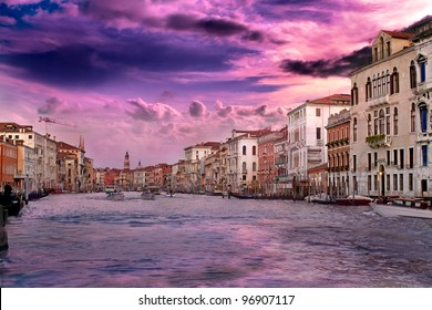 Beautiful sunset with vanilla sky over famous Grand Canal in Venice, Italy