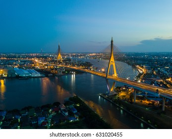 Beautiful sunset view from a drone of Bhumibol Bridge in Bangkok , Bridge of transportation for import , export , Bangkok ,Thailand