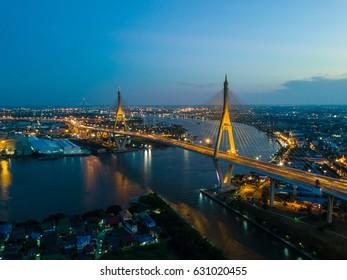 Beautiful sunset view from a drone of Bhumibol Bridge in Bangkok , Bridge of transportation for import , export , Bangkok ,Thailand