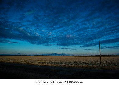 Beautiful sunset view of field with amazing clouds