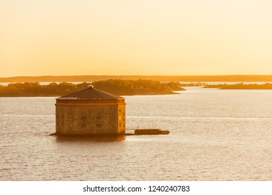 Beautiful sunset view on Godnatt naval keep (fortress in the sea for defense of naval harbor) in the Baltic Sea near Karlskrona, Sweden.