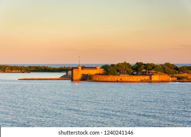 Beautiful sunset view on the island with Kungsholms Fort (coastal artillery fortress for control of Karlskrona harbour). Location place: the Baltic Sea near Karlskrona, Sweden.
