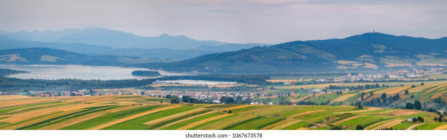 Beautiful sunset view on Orava villages and Orava dam with Rohace hills on the background from Klin, Slovakia