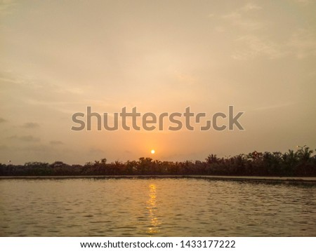 Beautiful sunset view with reflection in the lake water