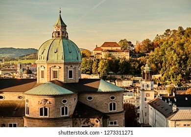 Beautiful sunset view of Salzburg Cathedral (Dom zu Salzburg) at Residenzplatz square in summer in Salzburg, Salzburger Land, Austria.