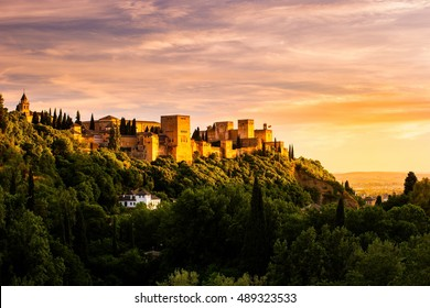 Beautiful sunset view of Spain's main tourist attraction, ancient arabic fortress of Alhambra, Granada, Spain
