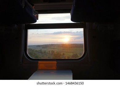 beautiful sunset view from the window of a train car
