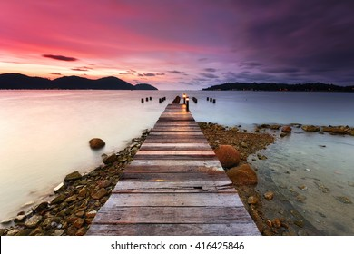 Beautiful sunset view with wooden jetty at Marina Island, Lumut Perak Malaysia. Nature composition.