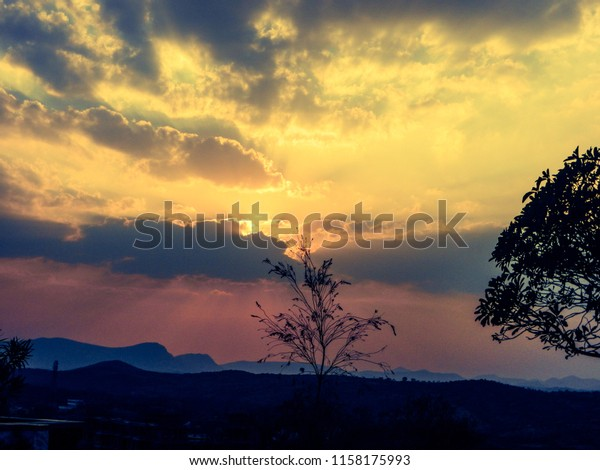 beautiful sunset view with yellowish pink evening
