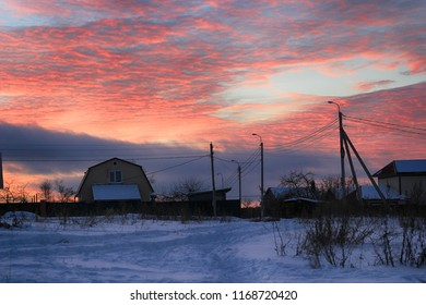 Beautiful sunset in a village in winter