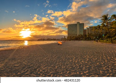 Beautiful sunset at Waikiki beach in Oahu. Waikiki beach, South Shore, is neighborhood of Honolulu and the most popular beach of Hawai.