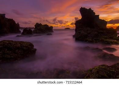 beautiful sunset at watulumbung beach