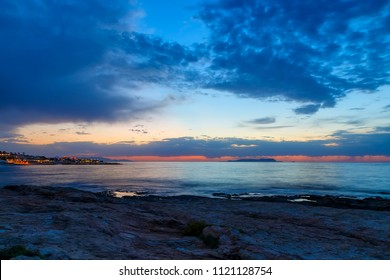 Beautiful sunset in western part of island of Crete, near town of Hersonissos. Seascape. Sunset over the sea.