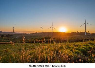 Beautiful sunset with Wind Turbine and blue sky background.