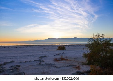 Beautiful sunset with wispy clouds and mountains at the Salton Sea in North Shore, California