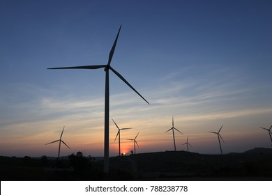 Beautiful Sunset within Wind Turbine field on the mountain.