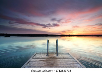 beautiful sunset at the wooden jetty at the beach