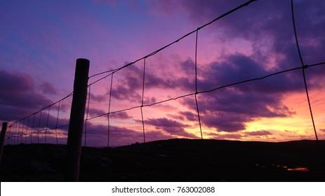 Beautiful Sunset/Sunrise Purple Red Golden Sky & Fence Silhouette Landscape, Nature of Scottish Highlands, United Kingdom