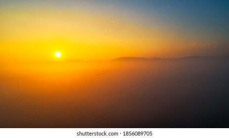 Beautiful sunsrise cloudy sky from aerial view. Airplane view above clouds