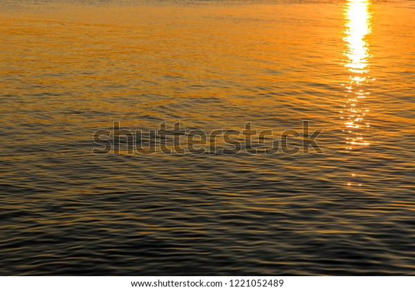 Beautiful sunst reflection in the water of the sea / lake
