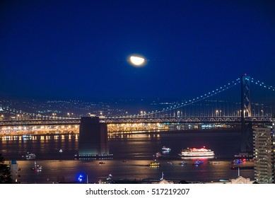 Beautiful Super Moon over San Francisco Skyline at Night Time