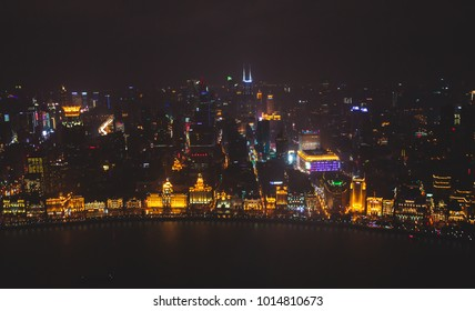 Beautiful super wide-angle night aerial view of Shanghai, China with Waitan, The Bund and scenery beyond the city, seen from the observation deck of Oriental Pearl TV Tower