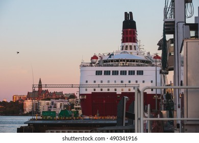 Beautiful super wide-angle panoramic aerial view of Stockholm, Sweden with harbor and skyline with scenery beyond the city, seen from the ferry, sunny summer day with blue sky