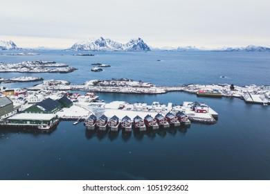 Beautiful super wide-angle winter snowy view of Svolvaer, Norway, Lofoten Islands, with skyline, mountains, Austvagoya island, Vagan municipality, Nordland, Northern Norway