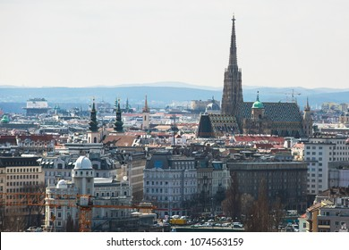 Beautiful super-wide angle aerial view of Vienna, Austria, with old town Historic Center and scenery beyond the city, shot from ferris wheel in Prater Park