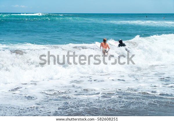 beautiful surf couple on a beach of indonesia