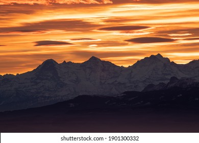 Beautiful surnrise with powerful colors with view on the Eiger, Mönch, Jaugfraujoch, La tourne, Neuchâtel, Switzerland