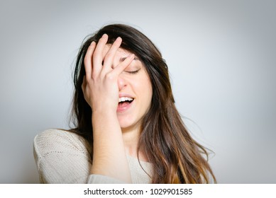 beautiful surprised girl laughs hard, isolated photo on background