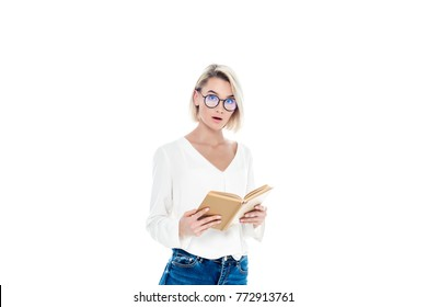 beautiful surprised student in eyeglasses reading book, isolated on white