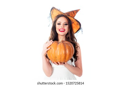 Beautiful surprised woman posing in witches Halloween costume - isolated on white background. Happy Halloween. Witch. Happy Halloween Witch with bright make-up
