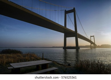 Beautiful suspension bridge. Blue and cold morning in Denmark.