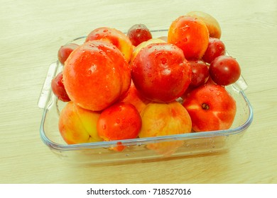 Beautiful sweet peaches, nectarine and plums. Ripe fruit on the table - Retro color