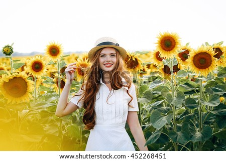 7d7bf48c58 beautiful sweet sexy girl in a white dress walking on a field of sunflowers