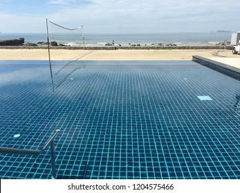 A beautiful swimming pool near the beach.