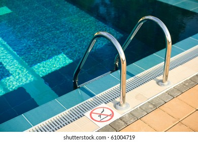 beautiful swimming pool with no swimming sign