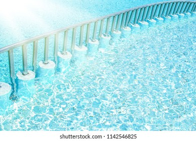 Beautiful swimming pool at the seaside hotel in park background