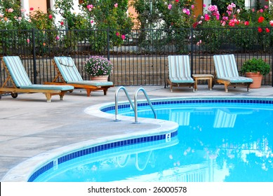 beautiful swimming pool surrounded by chairs and flowers