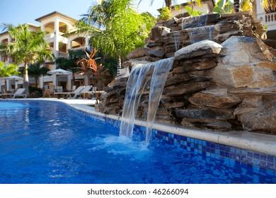 Beautiful Swimming Pool Waterfall In The Caribbean