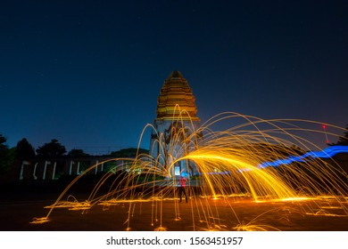 Beautiful Swing fire dancing show at night background.Swirl Steel Wool light Photography at Stone castle at Koh Klang nam public park in Sisaket Thailand. - Shutterstock ID 1563451957