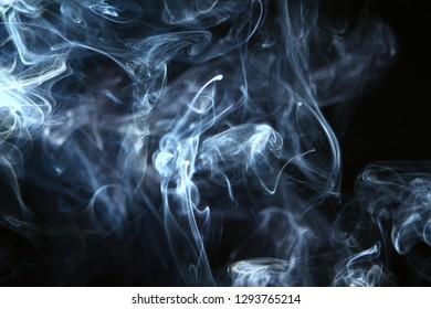 beautiful swirl glowing bright smoke against black background.