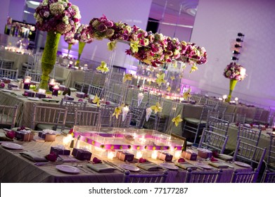 Beautiful table decorated with flower centerpieces for a reception