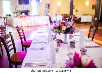 Beautiful table decoration with fresh flowers and accessoires