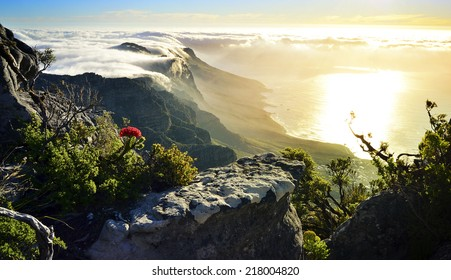 Beautiful Table Mountain covered in clouds at sunset