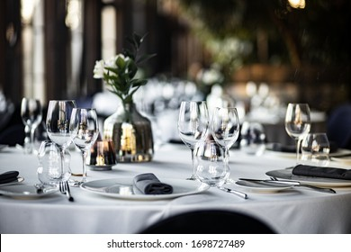 Beautiful table set for an event party or wedding reception . restaurant interior