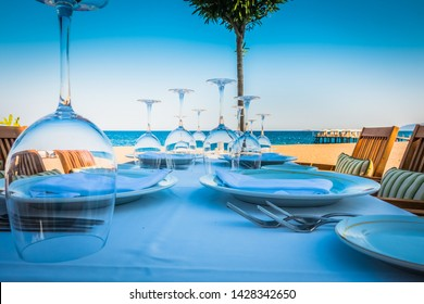 Beautiful table setting in a seaside restaurant